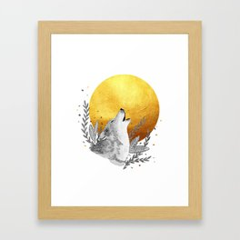 Grey wolf howling to gold moon Framed Art Print