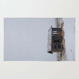 Hopeless, Abandoned, and Alone Under Grey Snow Filled Sky Rug