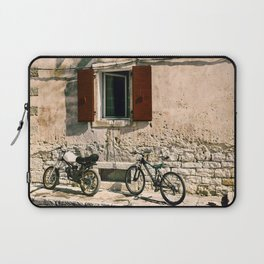 Two bikes against the wall Laptop Sleeve