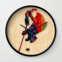 hockey Wall Clocks featuring Hockey by marvinblaine