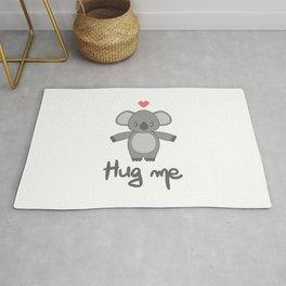 cute hand drawn lettering hug me with cartoon lovely koala bear Rug
