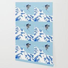 Airborn Skier Flying Down the Ski Slopes Wallpaper