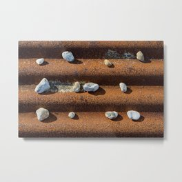 Pebbles on rust Metal Print