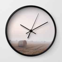 Round bales in a stubble field bound with fog at dawn. Norfolk, UK. Wall Clock