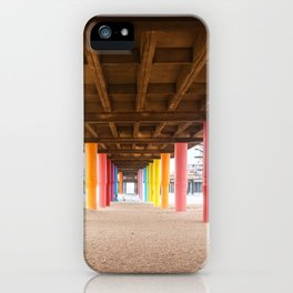 Pier with color painted columns on the beach iPhone Case