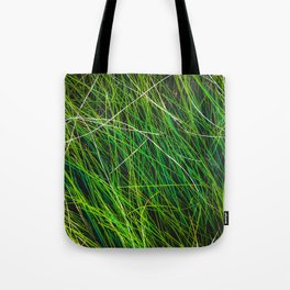 closeup green grass field texture abstract background Tote Bag