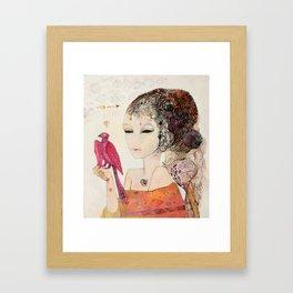 Crimson bird Framed Art Print
