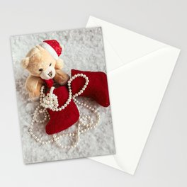 A soft bear toy on the snow background Stationery Cards