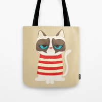 meme Tote Bags featuring Grumpy meme cat  by UiNi