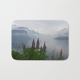 Lupine flowers with mountains landscape Bath Mat