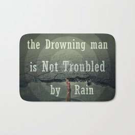 the drawning man is not troubled by rain Bath Mat
