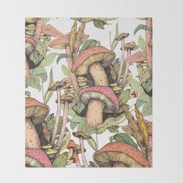 mushrooms in the wild Throw Blanket