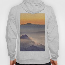 Top in fog. Misty mountains at sunset Hoody