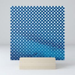 White polka dots and snorkel blue background with blur Mini Art Print