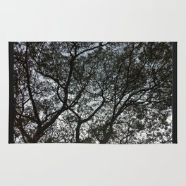 Under the trees II Rug