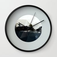 hemingway Wall Clocks featuring Island at Sea by Three of the Possessed
