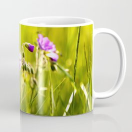 Beautiful meadow flowers - geranium on a sunny day - brilliant bright colors Coffee Mug