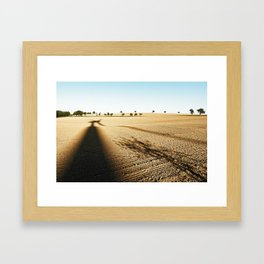 Shadow of a pinwheel on a hilly landscape with individual trees Framed Art Print