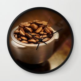 Coffee Beans on coffee filter over wood table Wall Clock