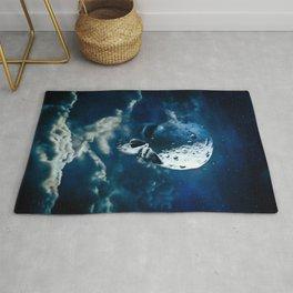 Reaper Moon Rising / 3D render of cratered skull moon in night sky Rug