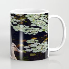Ducks swim in the summer along the river on the water Coffee Mug