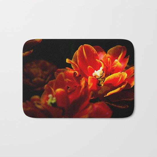 Red tulips dark background Bath Mat