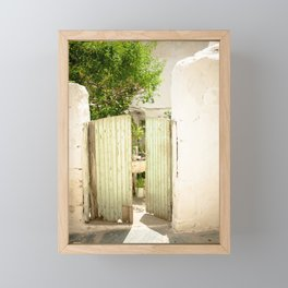 Green Gate in white wall Crete, Greece Framed Mini Art Print