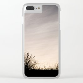 Silhouette in grass and clouds Clear iPhone Case