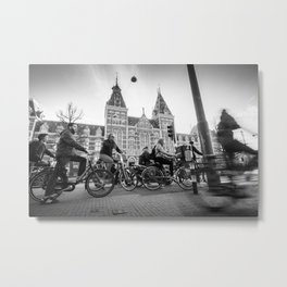 Cyclists ride in Amsterdam street in front of the Rijksmuseum Metal Print