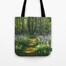 Path through wild Bluebells in ancient woodland. Wayland Wood, Norfolk, UK. Tote Bag