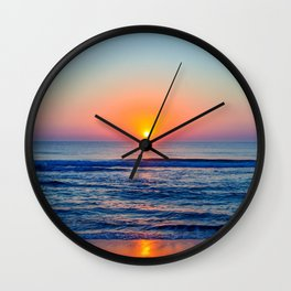 kill devil sunrise Wall Clock