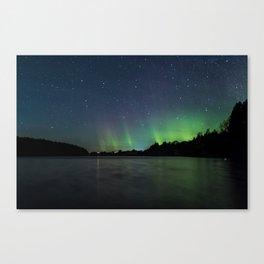 Northern Lights above a lake Canvas Print