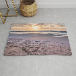 Love note Te Amo with the heart drawing on the beach at sunrise Rug