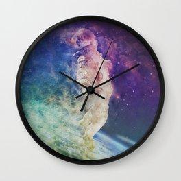 Astronaut dissolving through space Wall Clock