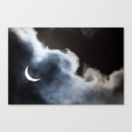 Partial solar eclipse viewed through clouds Canvas Print