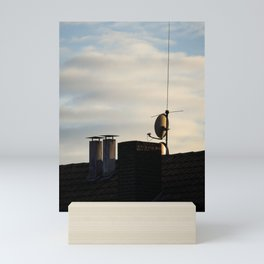 Rooftop with chimneys and a satellite dish Mini Art Print