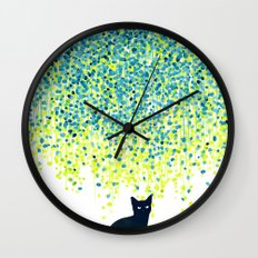 Cat in the garden under willow tree Wall Clock