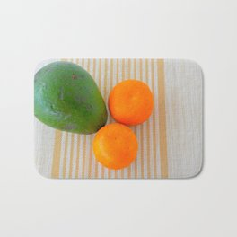 Fruit avocado and oranges. Bath Mat