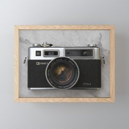 Yashica electro 35 on white marble Framed Mini Art Print