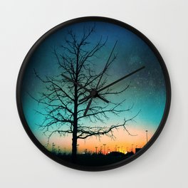 Sunset in space Wall Clock