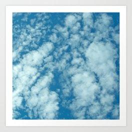 Fluffy clouds in a blue sky Art Print