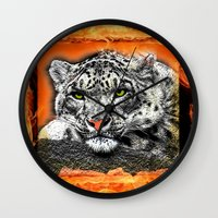 snow leopard Wall Clocks featuring Snow Leopard by SwanniePhotoArt