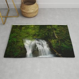 Scenic Waterfall in a Forest Rug