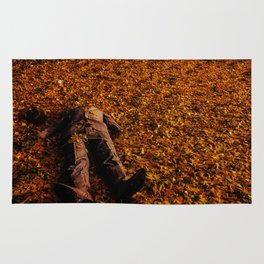 Man Lost in Autumn Leafes Rug