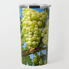 Delicious growing green grapes bunch farming on a beautiful blue summer sky background Travel Mug