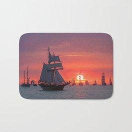 Windjammer with sunset Bath Mat