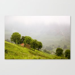 House between hills Canvas Print