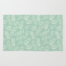 Painted Leaves - a pattern in cream on soft mint green Rug