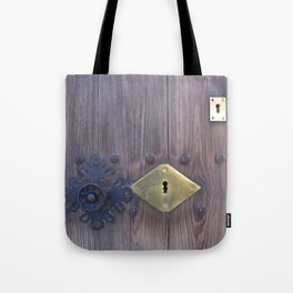 Old door knob with keyholes Tote Bag