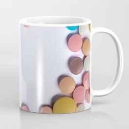Numerous colorful pills on white background. Coffee Mug